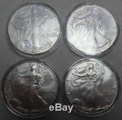 20 ASE 2004 silver eagles in Air-Tite acrylic holders= 1 Roll Uncirculated coins